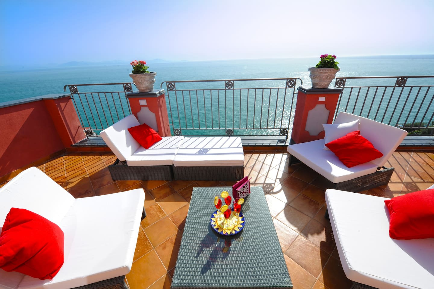 Large terrace with great amazing sea view with wicker sun loungers, outdoor shower, dining table and barbecue.