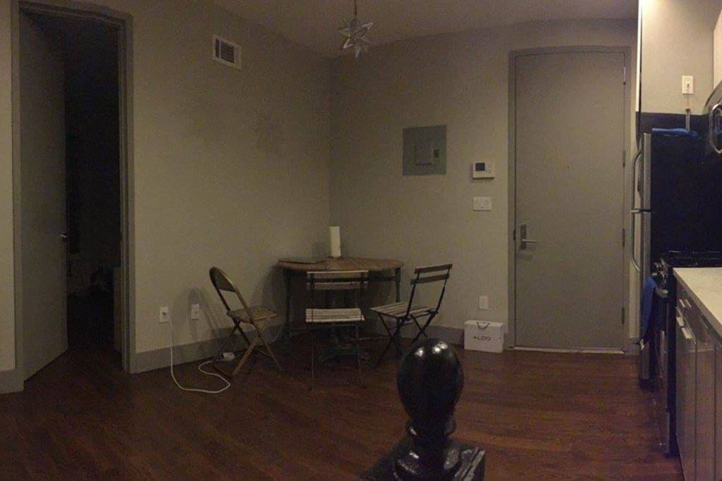 Kitchen/living space. Includes table, chairs, fridge, stove, and microwave.