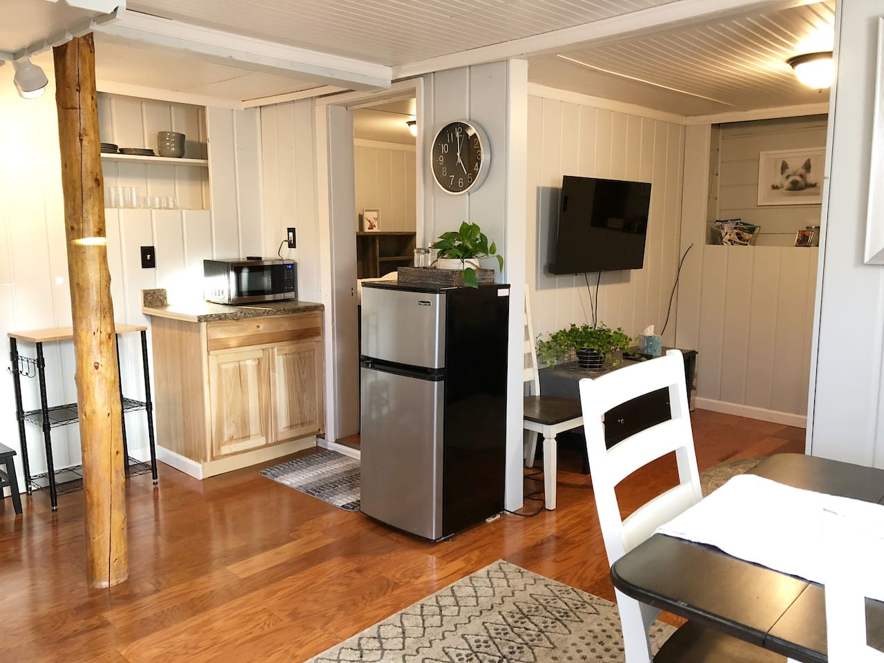Small kitchenette, dining area with view of bedroom entrance and living room area