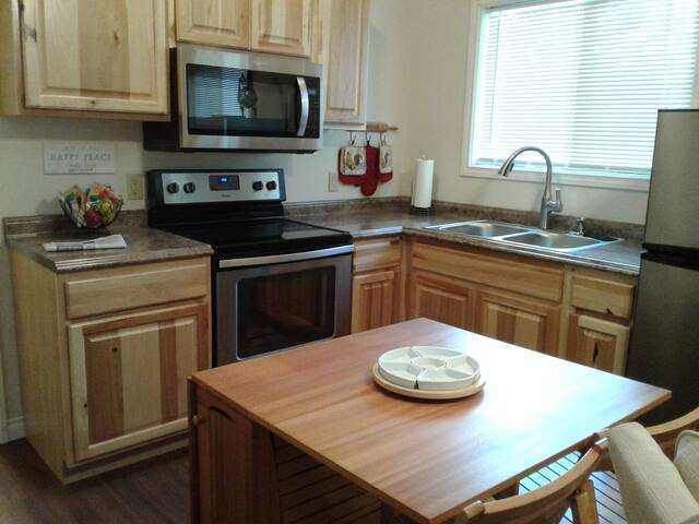 Small kitchen table with fold out side to enlarge for four place setting.  Full kitchen.