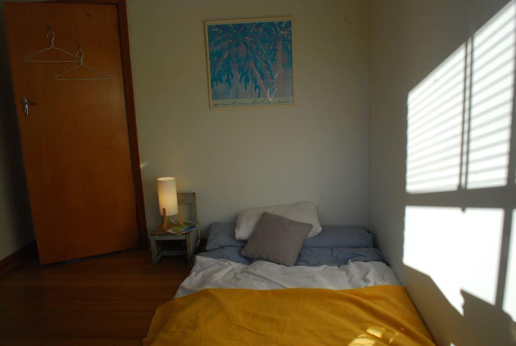Private, modern sun filled bedroom with 100% Japanese Cotton Futon. Sleeps 2.