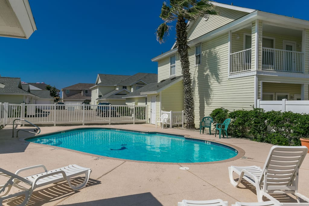 Relax by the shared pool located near your rental.