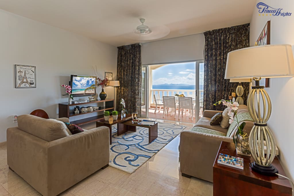 Living room area with Flat screen tv, pull out sofa and balcony with Ocean views to the Atlantic