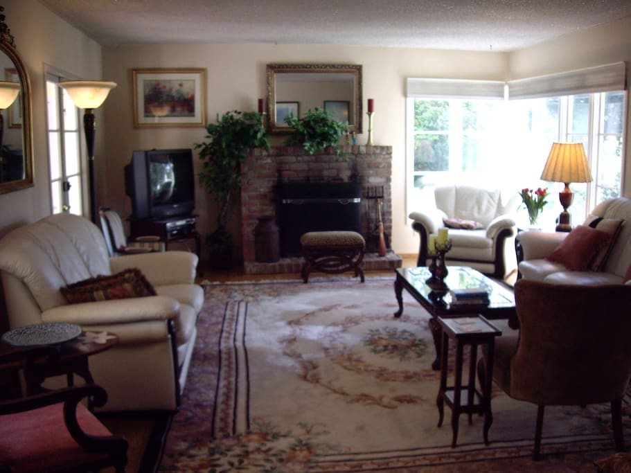 Comfortable and large living room with  french doors opening to front patio