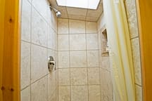 Wow - a travertine shower in a Cabin? With a skylight!