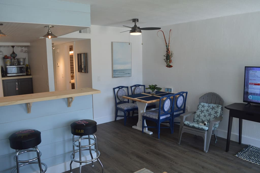 Open concept kitchen and living room keeps the vacation conversation going.