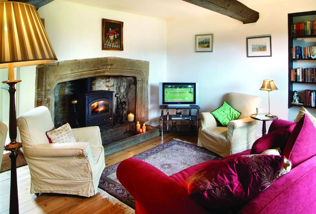 Ground floor: Sitting/dining room with wood burning stove