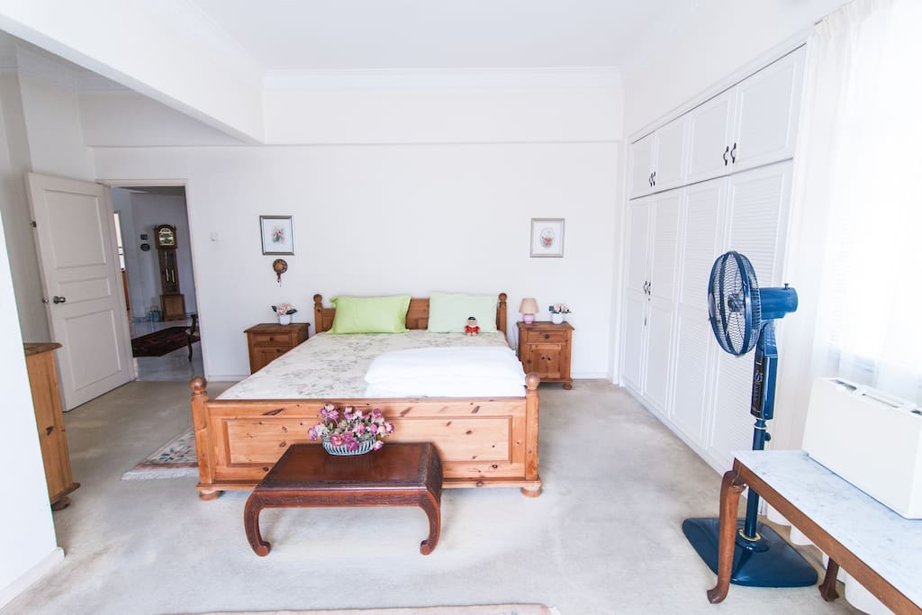 Large airy room with king size bed, plenty of closet space, private bathroom and balcony.