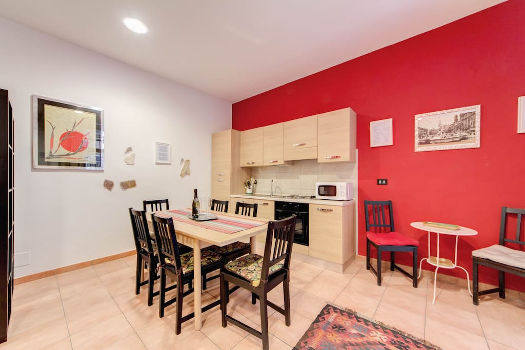 your air conditioned fully equipped kitchen  with dining table for 8..