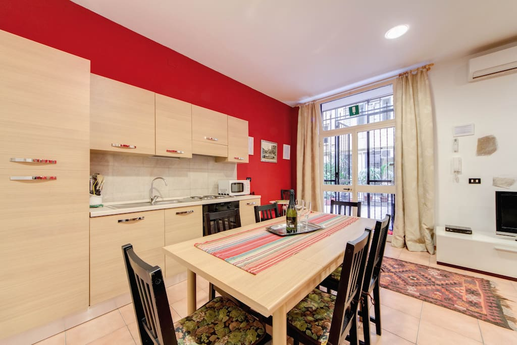 fully equipped and air conditioned kitchen + dining area...