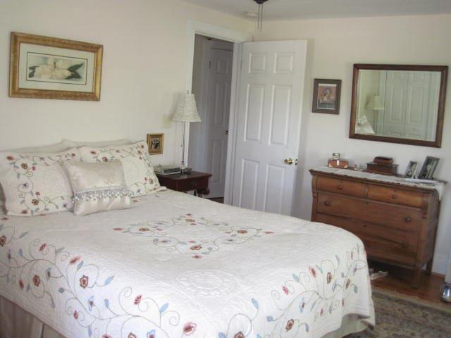 Second floor Master bedroom with Queen bed shared bath.