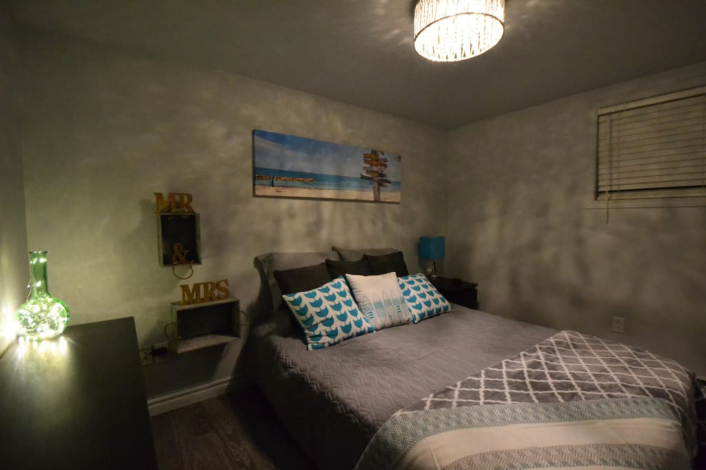 Bedroom with queen size bed and google mini