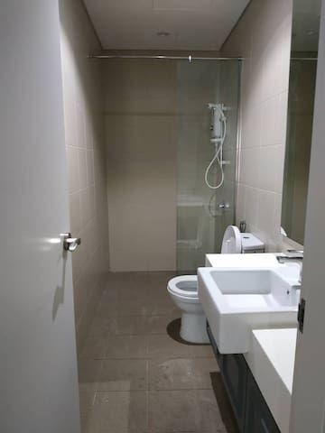Bathroom with Water Heater Shower gel and shampoo provided Towel provided 4pc