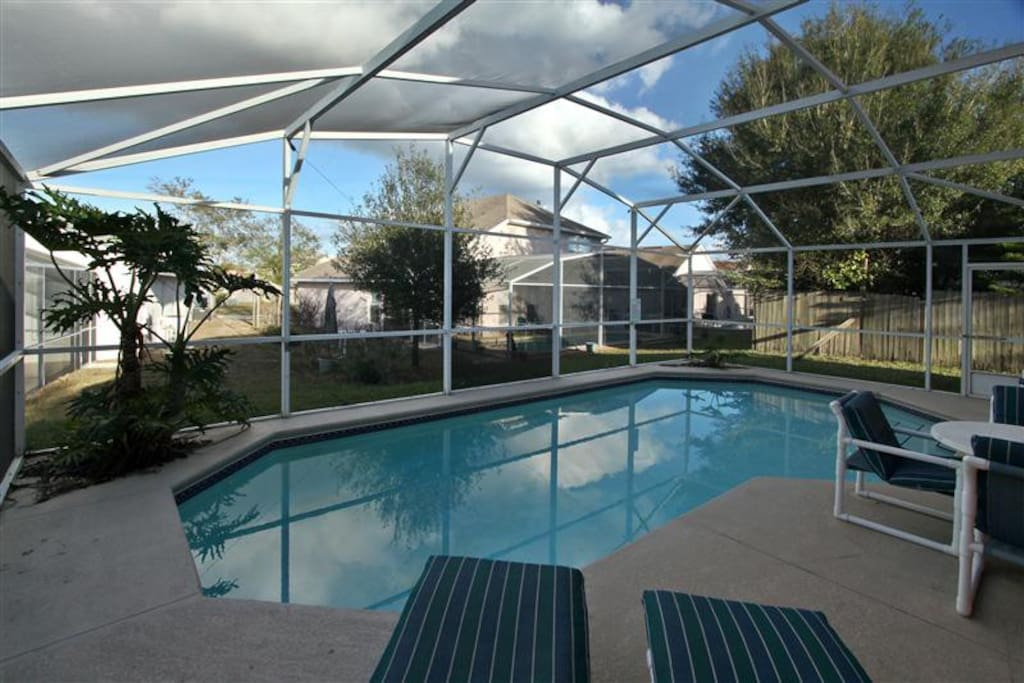 Large Private Pool with Patio and Furniture