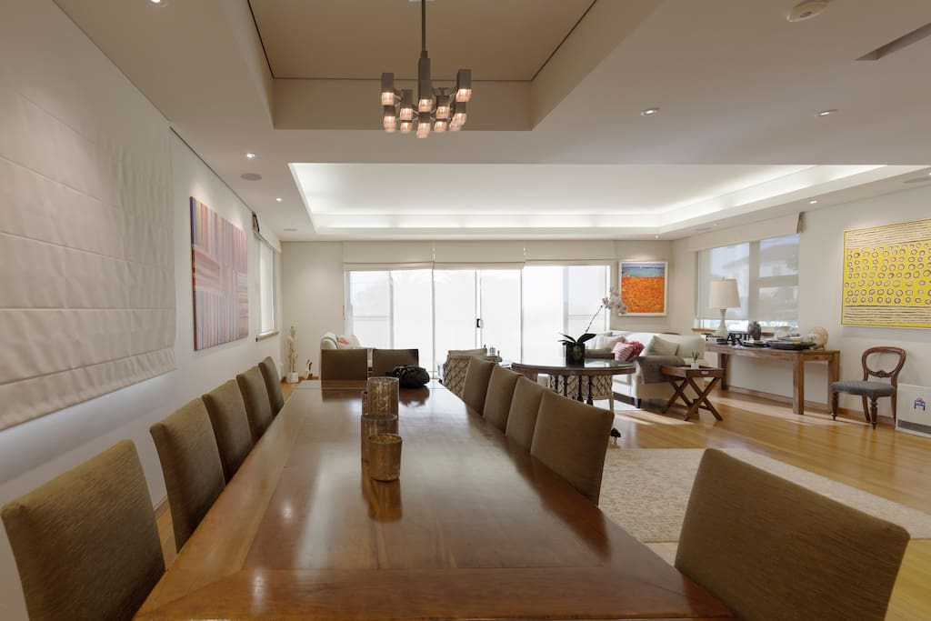 Formal dining with front lounge area. The balcony has views across Sydney and the Harbour Bridge