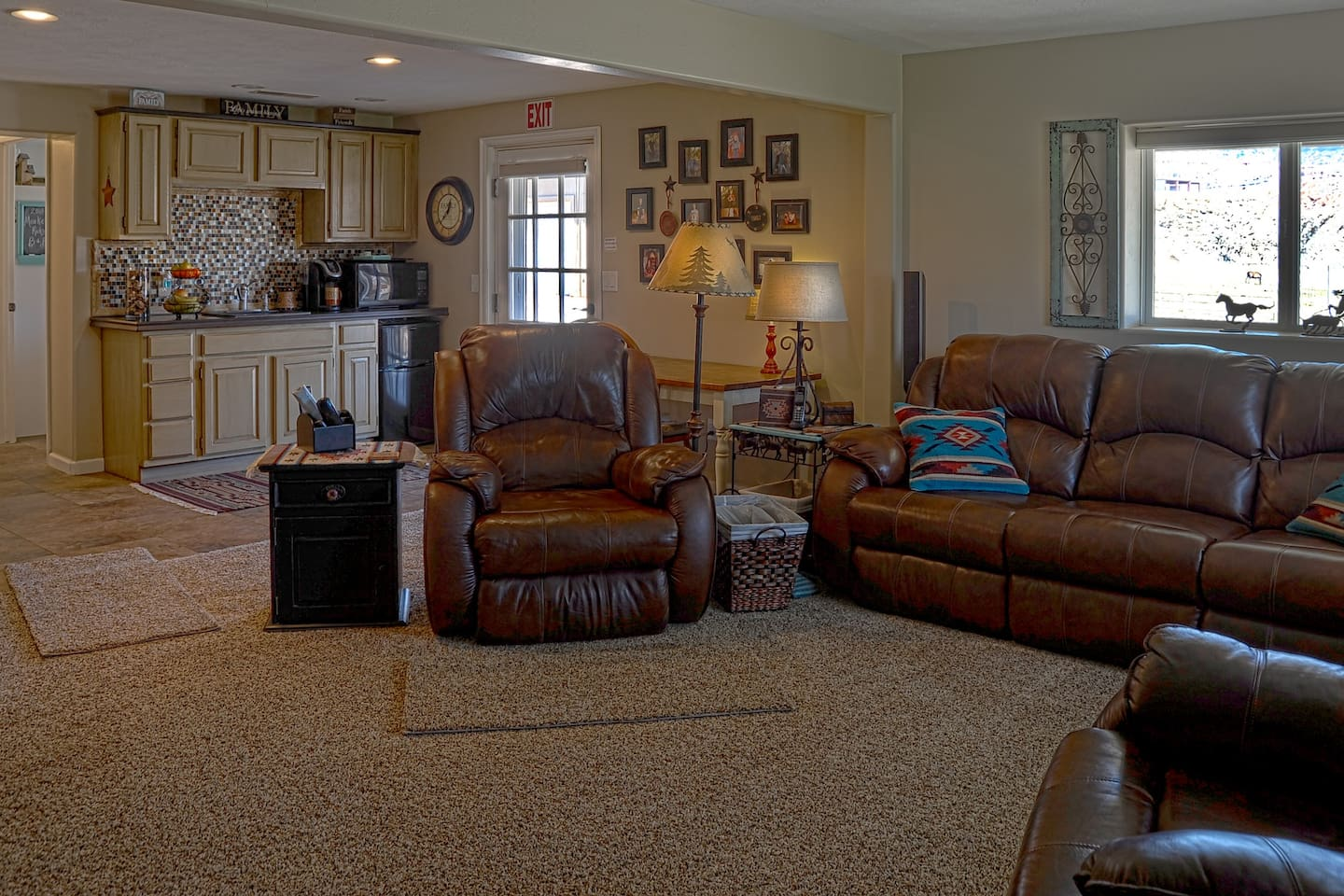 Enjoy breakfast in the kitchenette or Relax in large comfy family room with table and chairs