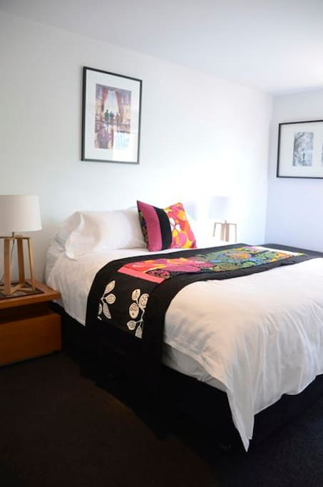 Bedroom 1, with luxurious manchester and pillow top queen bed.  Air conditiong and heating.