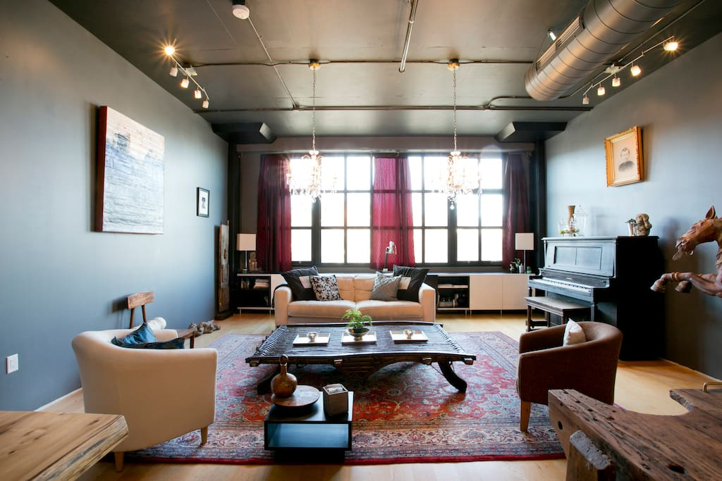 A view of the main living space from the dining area, the width of the unit is larger than most of lofts in the Pearl at 19-ft