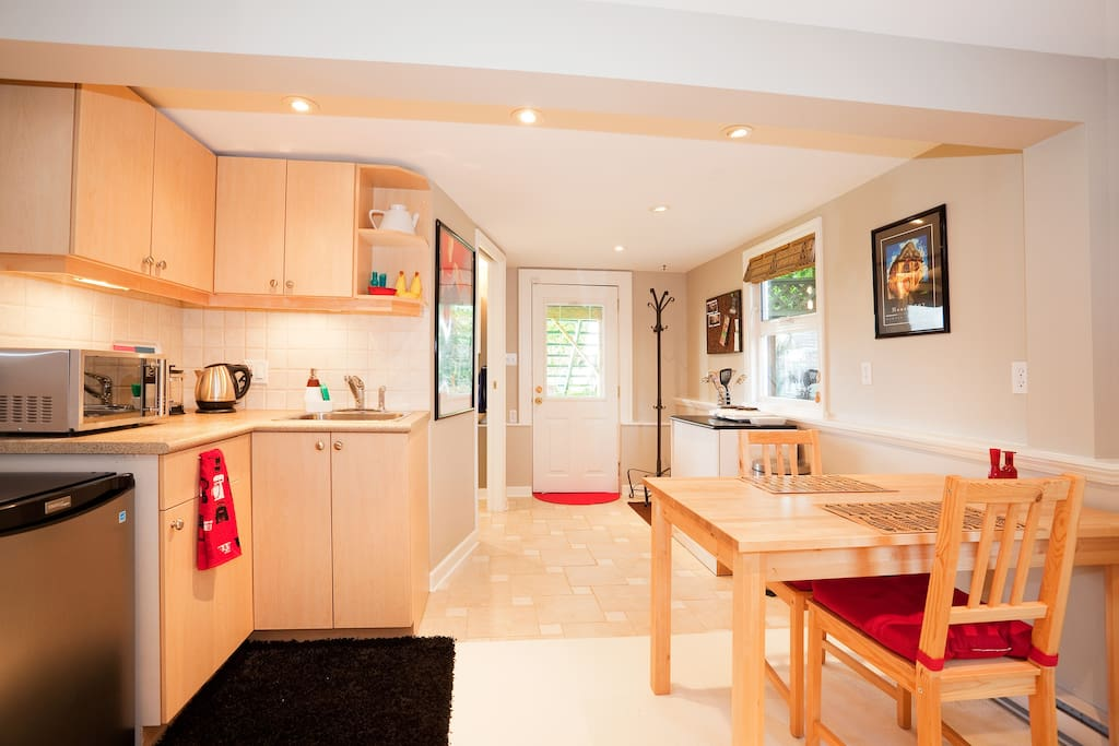 Kitchen and dining area with private entrance to the sunny patio and back garden