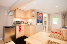Corner kitchen with fridge, microwave, kettle and coffee and tea at the ready