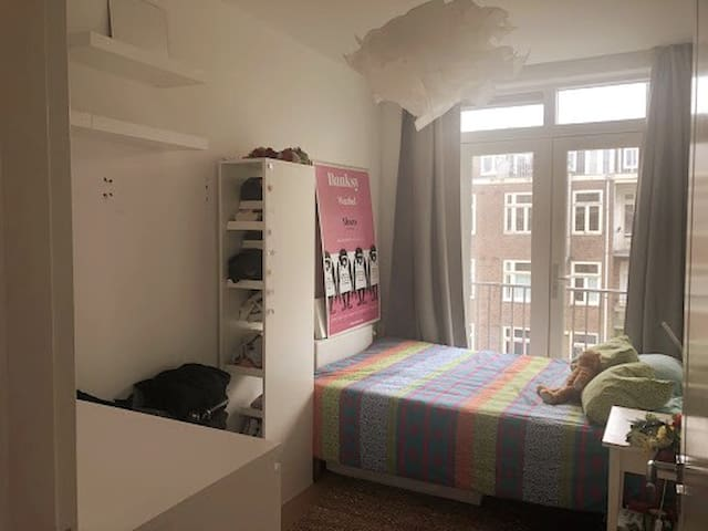 Cosy room in modern apartment, with roof terrace