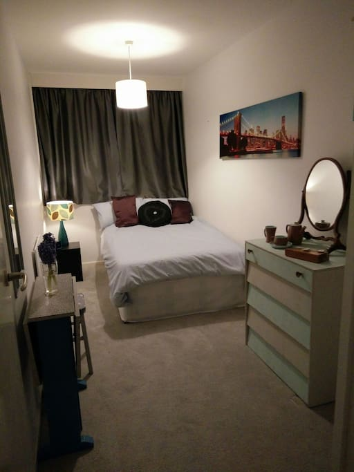 The bedroom on offer, complete with small foldout desk if you need to work.