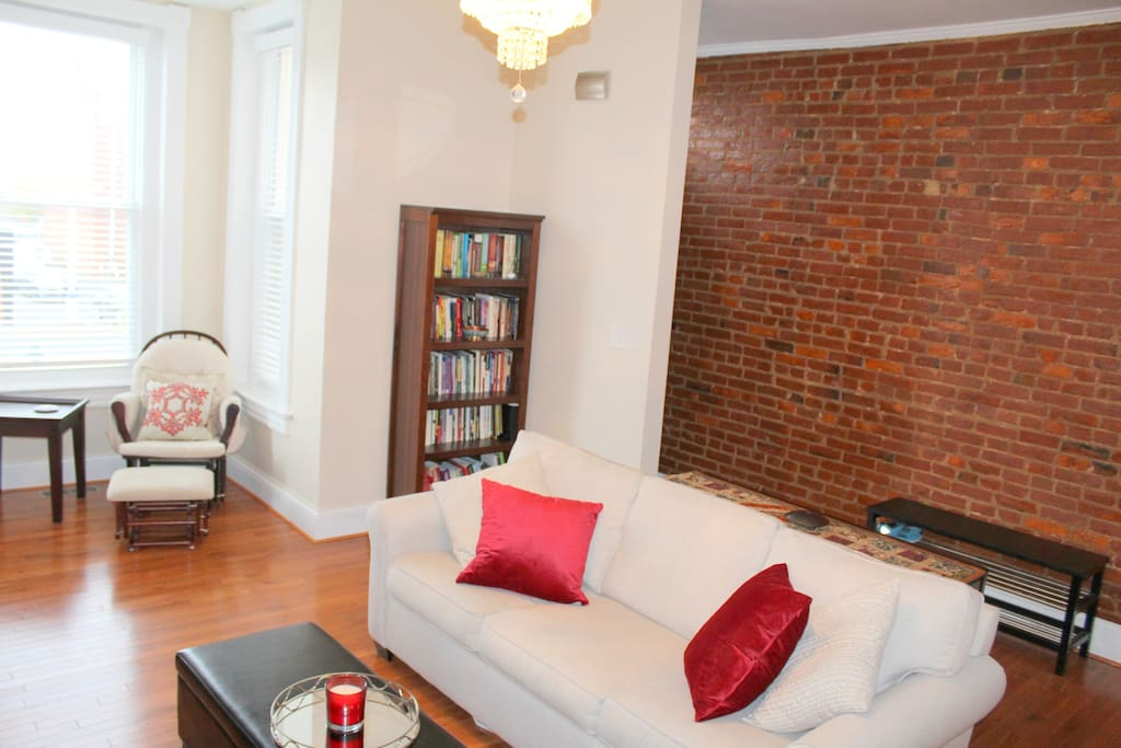 Renovated 1890s charming row home with classic exposed brick wall