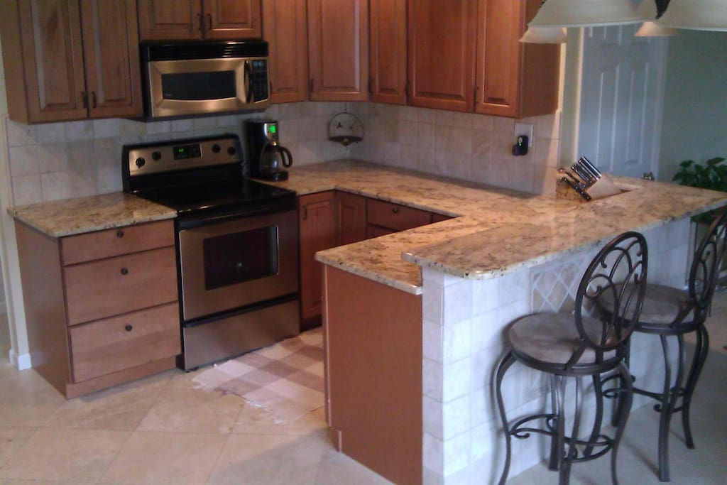 Granite kitchen counters with stainless appliances