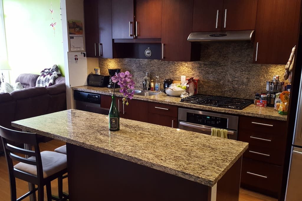 Fully equipped kitchen with an island and two chairs