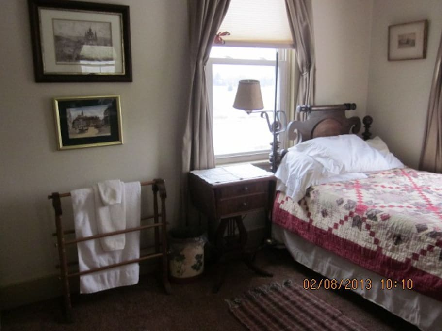 Quilt Room with Antique furniture and 3/4 Bed