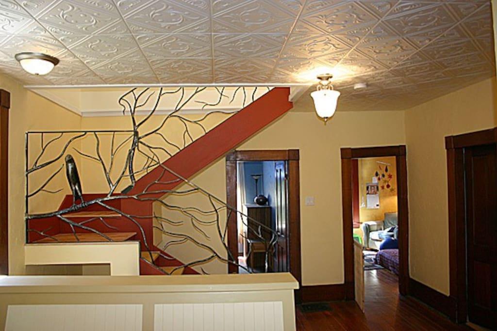 Stairway and doorways to second floor bedrooms