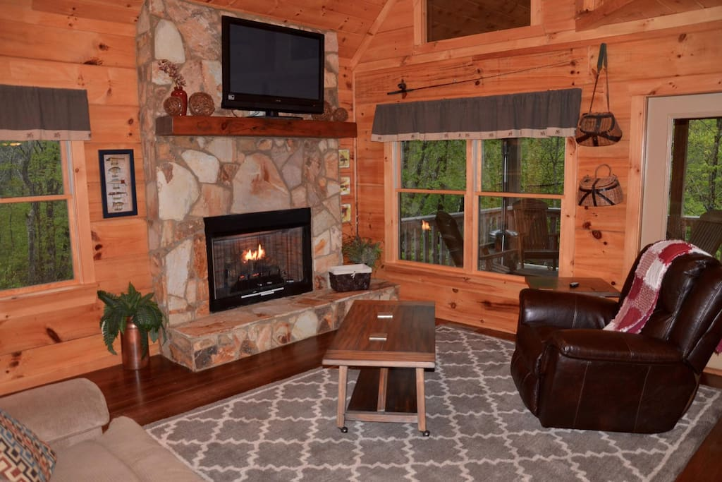 Relax by the fireplace and large flat screen TVs.