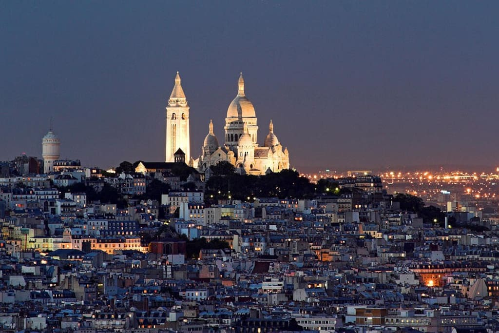 view of montmartre by night