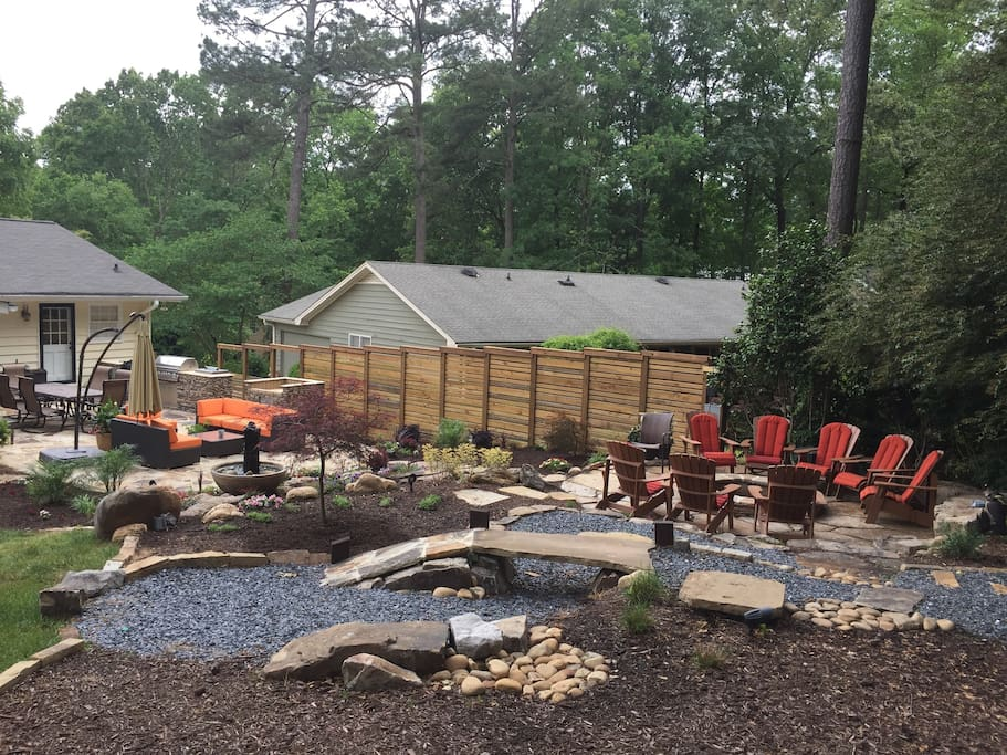 Backyard view - zen garden, fire pit, outdoor dining with kitchen