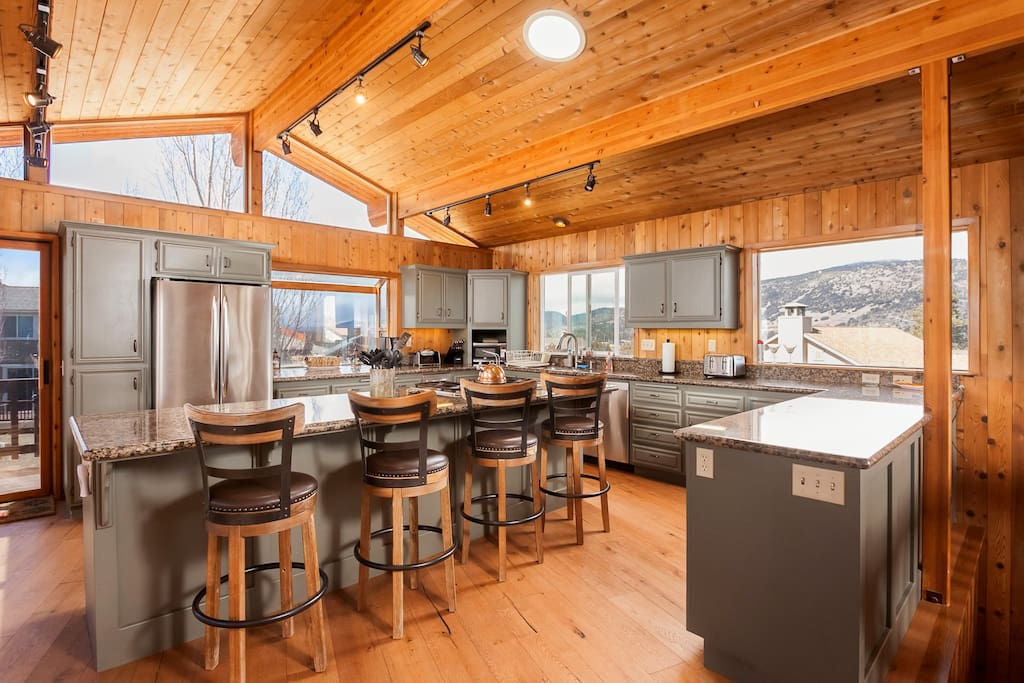 Kitchen with Expansive Granite; Bar Stool Seating and New Wood Floors