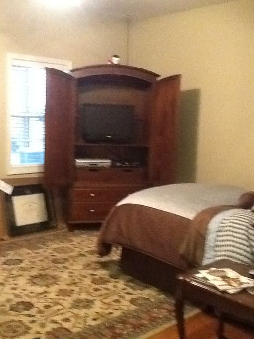 Bed and entertainment center