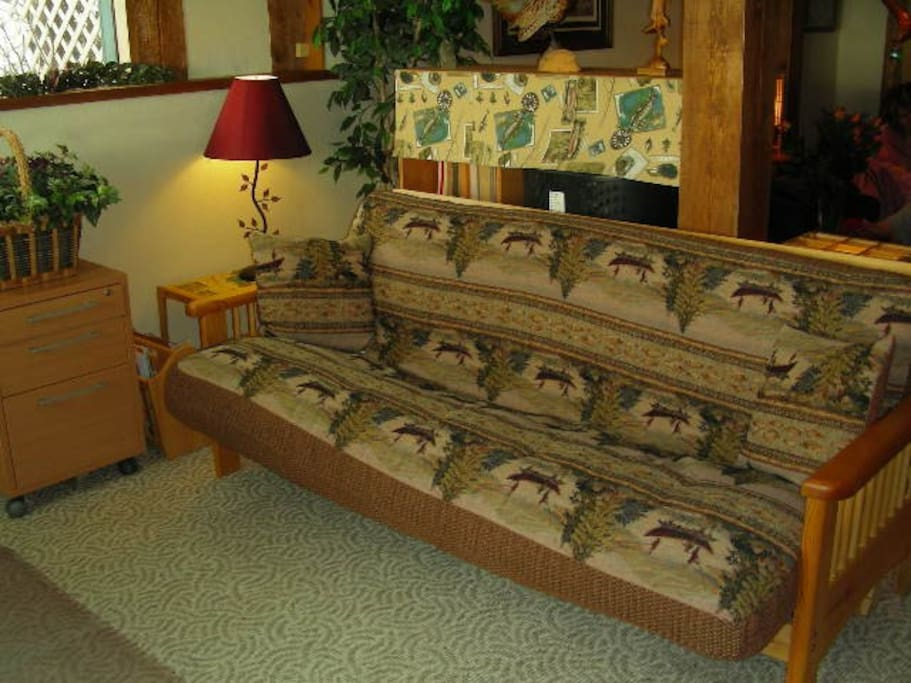 Futon bed for additional guests, or for relaxing and reading in our study/work area