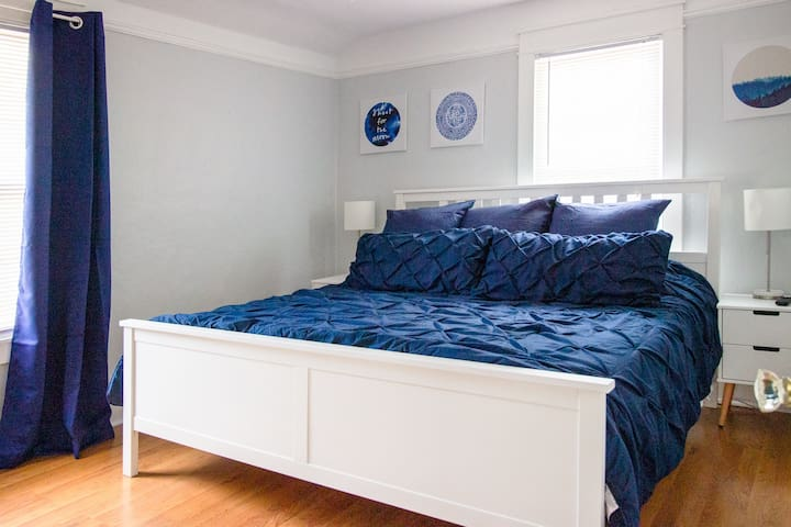 The master bedroom features a King-size bed, two nightstands, and a TV equipped with an Amazon Fire Stick for guests to access their personal Amazon Prime account.