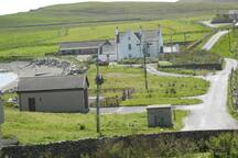 Hillswick Manse with the seabarn to the left