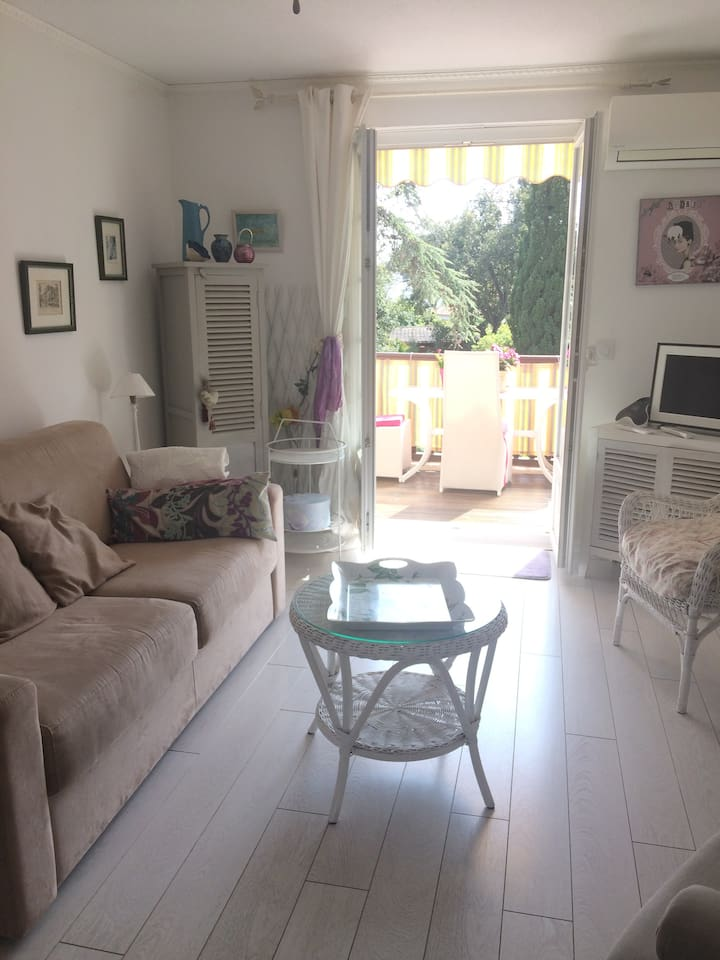 Bright living area, facing on to the landscaped gardens. Contains double sized sofa bed.