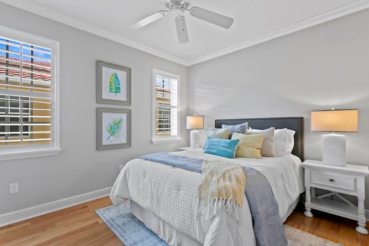Upstairs guest bedroom #2 with queen bed + TV