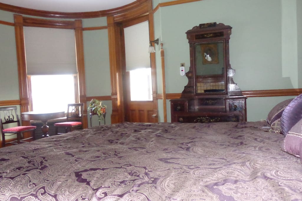 View of sitting area, door to balcony, and dresser