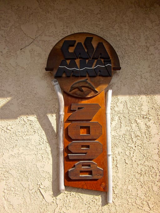 My husband Bill is a sculptor who works in wood and does many thing on special order, including this house sign for his wife!