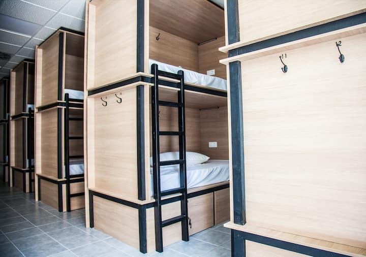 1 cama en habitación de 12 personas