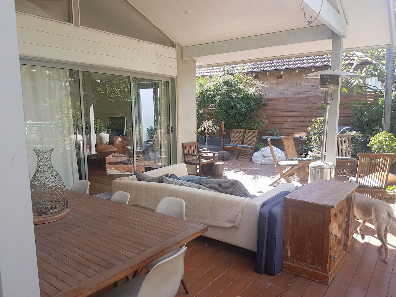 Rear Deck with dining and lounge areas.