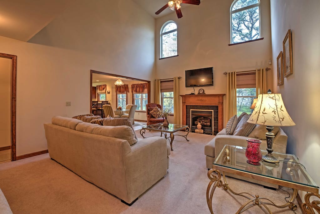 An elegant, open-concept living space with high vaulted ceilings awaits you at this Pocono Summit vacation rental house!