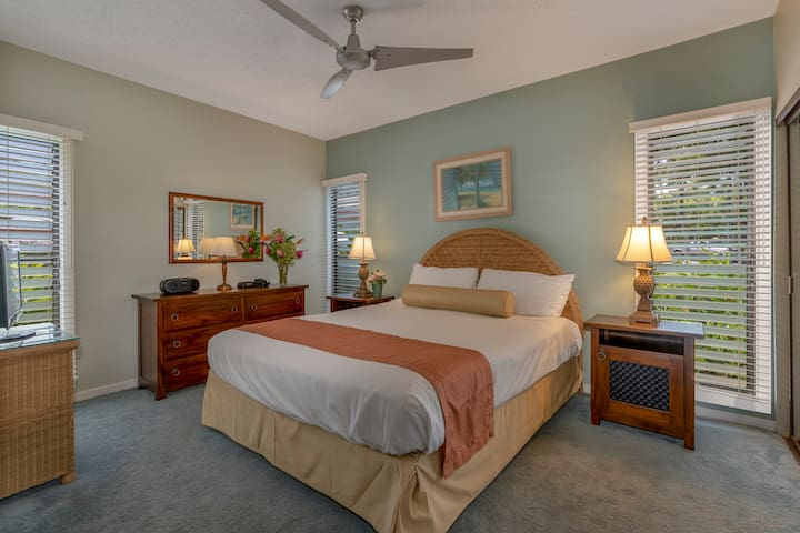 King-size bed and dressers with ceiling fan to keep cool