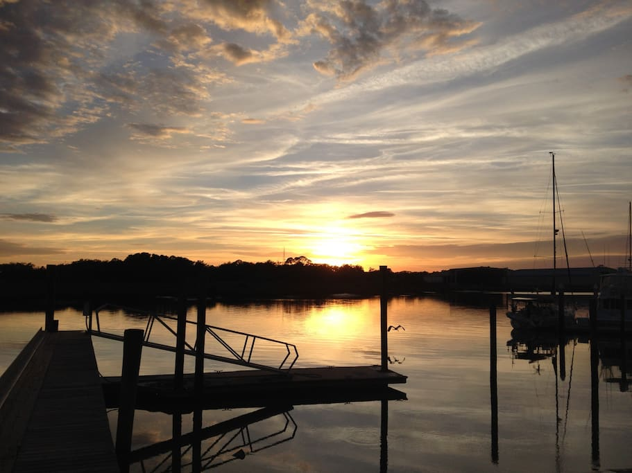 The sun sets on New Year's Eve 2016 over San Sebastian river at boatyard two blocks from house.
