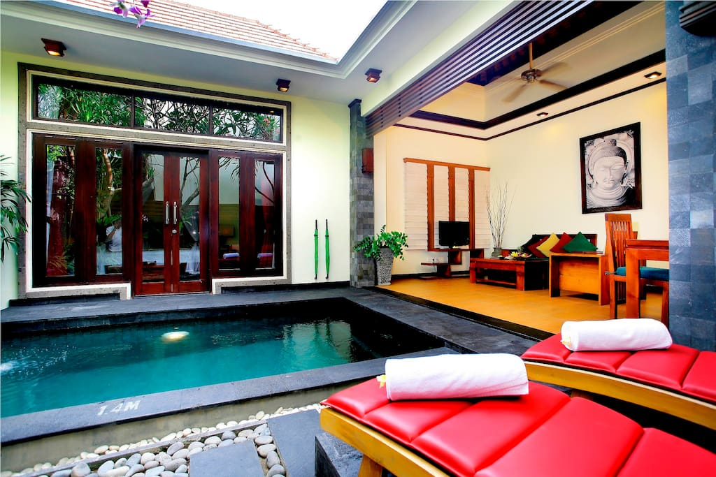 Sun loungers by the pool and open air living room