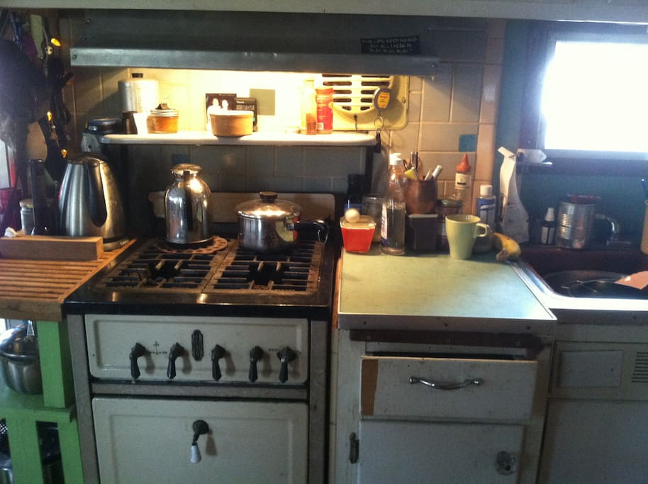 antique stove and original blue counters.